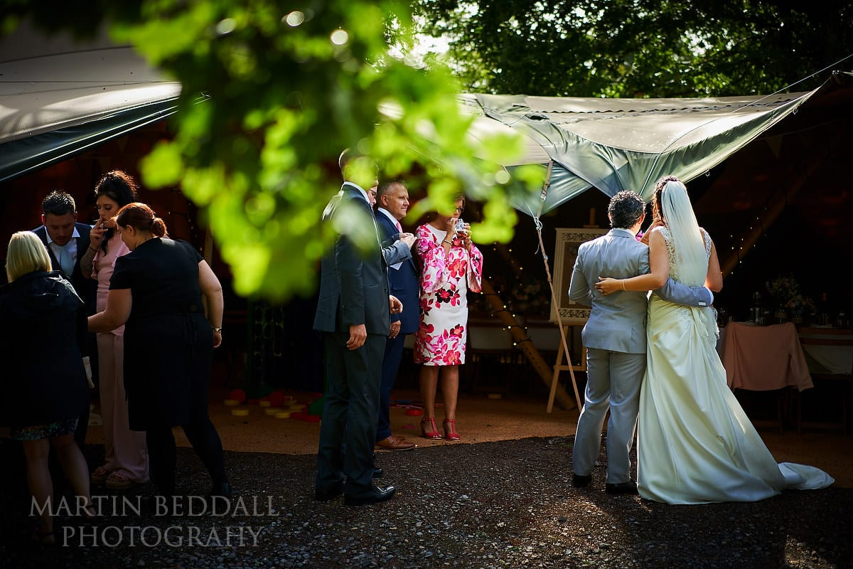 Bride and groom pose for pictures at Five Oaks Events