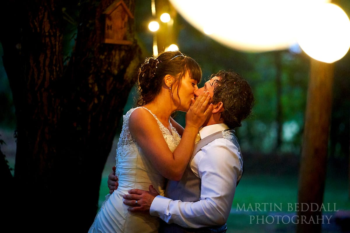 Couple kiss at Five Oaks Events