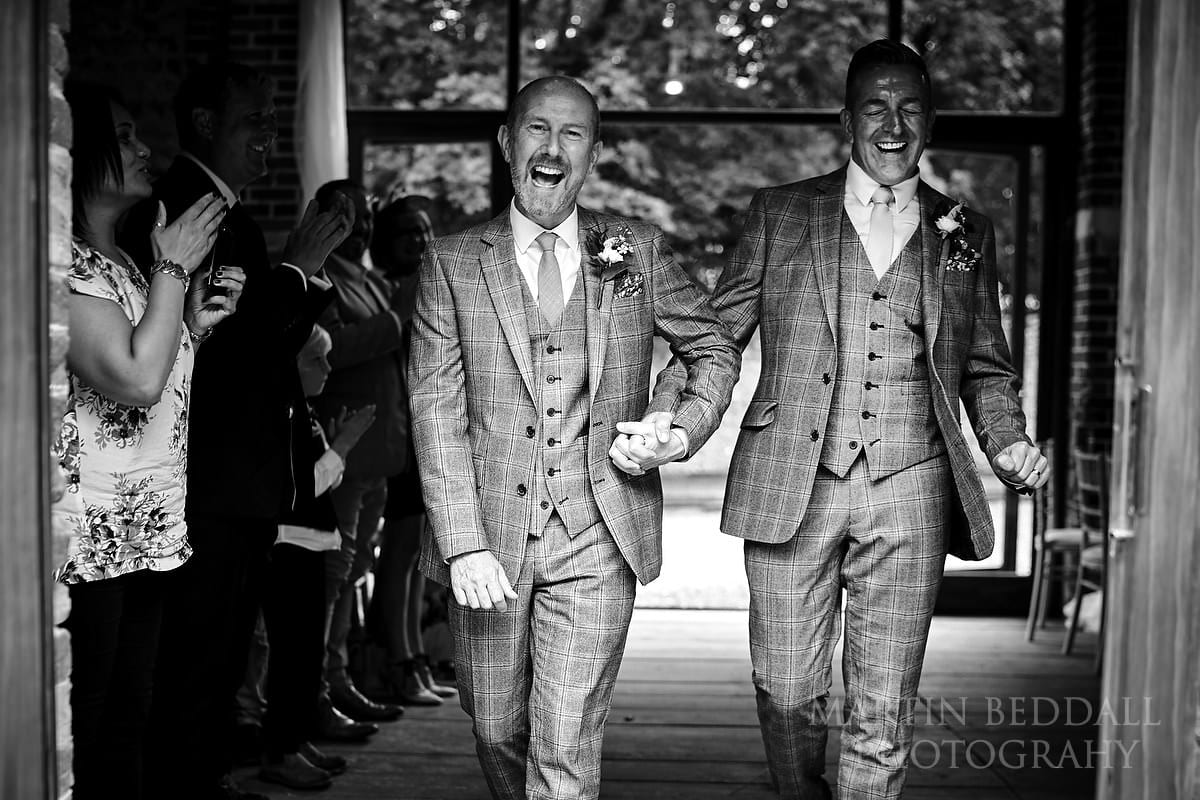 Two triumphant grooms