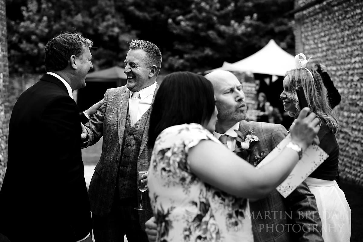 Grooms with friends outside the barns