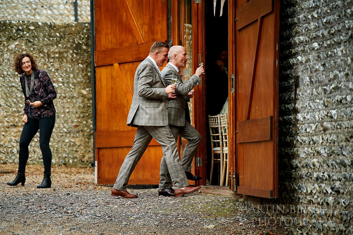 Grooms announced into the barn