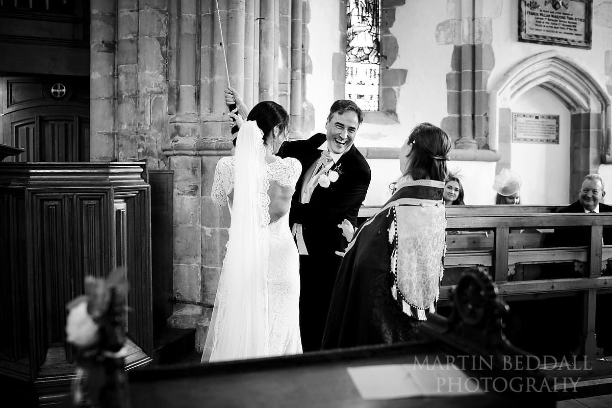 Bride and groom ring the church bell