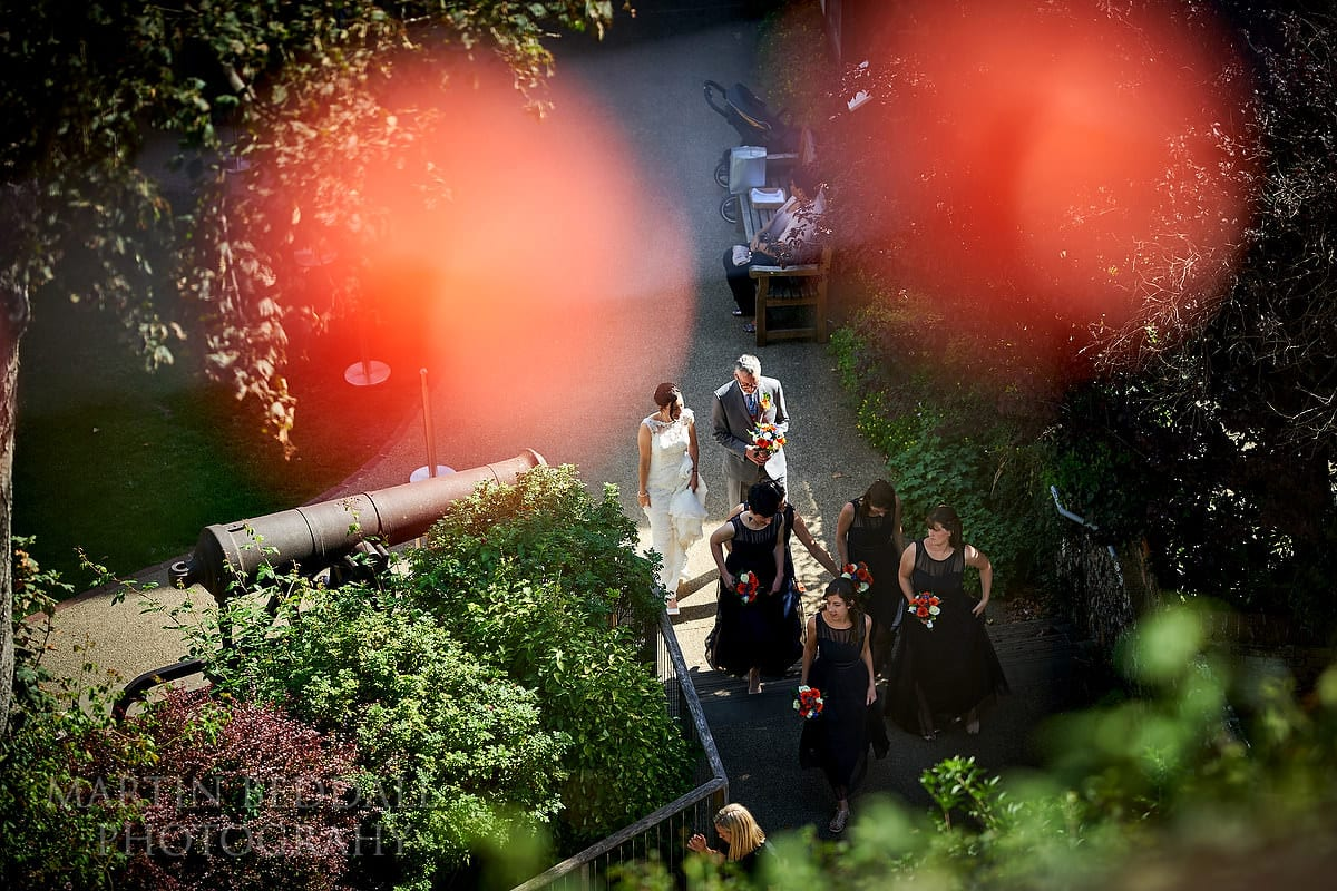 Bridal party starts to walk up the Motte at Lewes Castle
