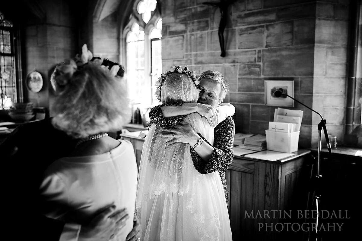Hug from their mothers in the vestry