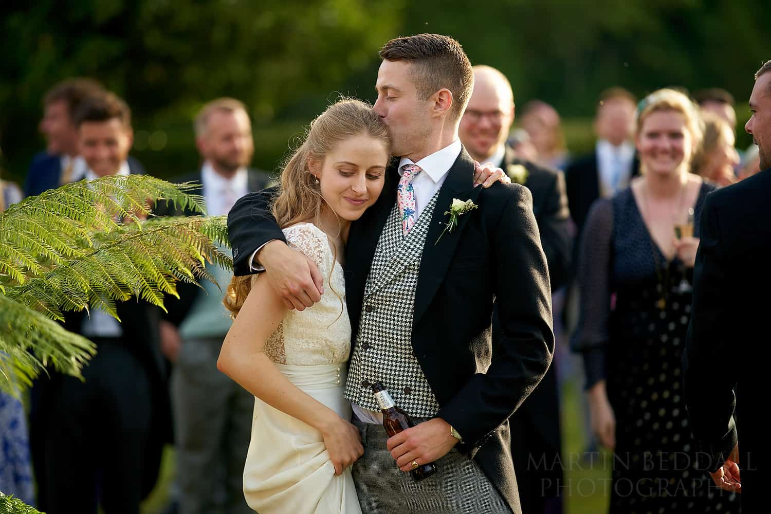 bride hugged by her brother