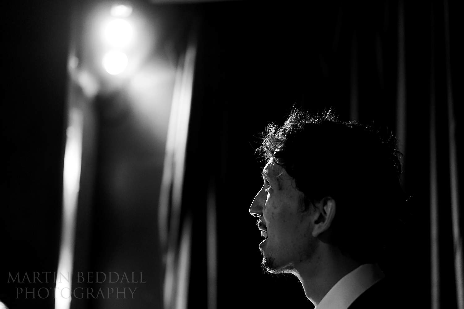 Groom waits on the stage at the Little Theatre cinema in Bath