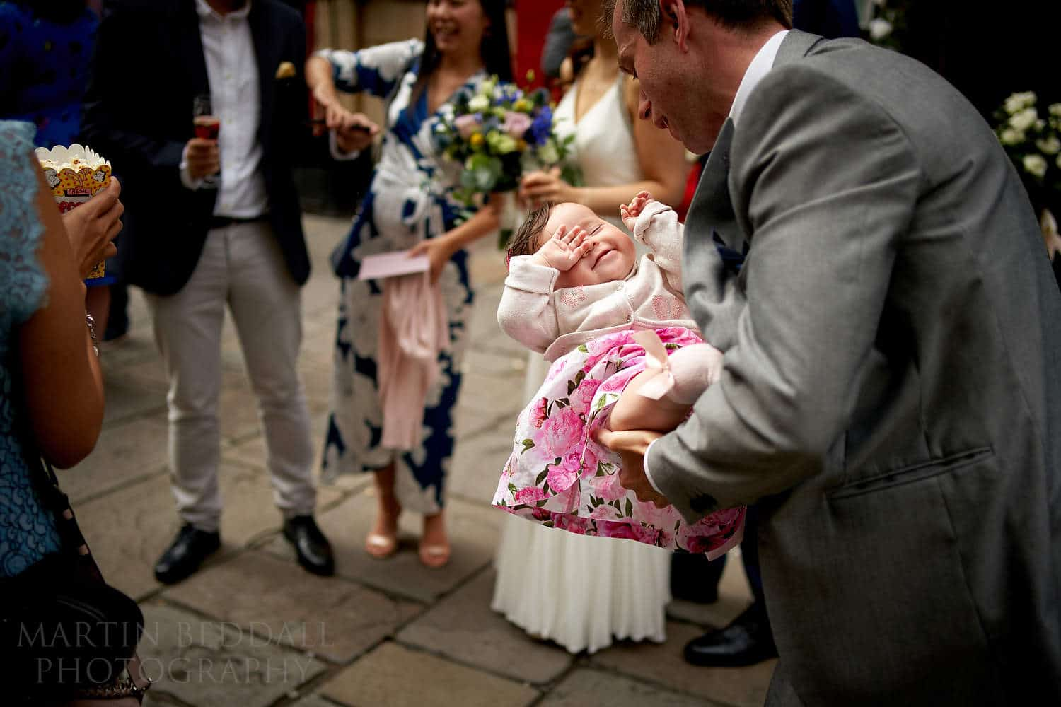 Young wedding guest rocked