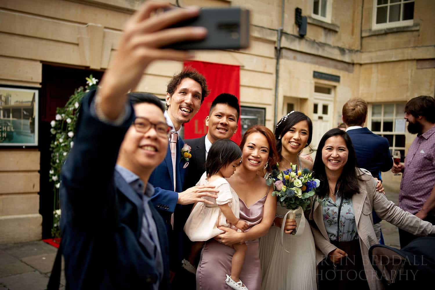 Selfie with the bride and groom