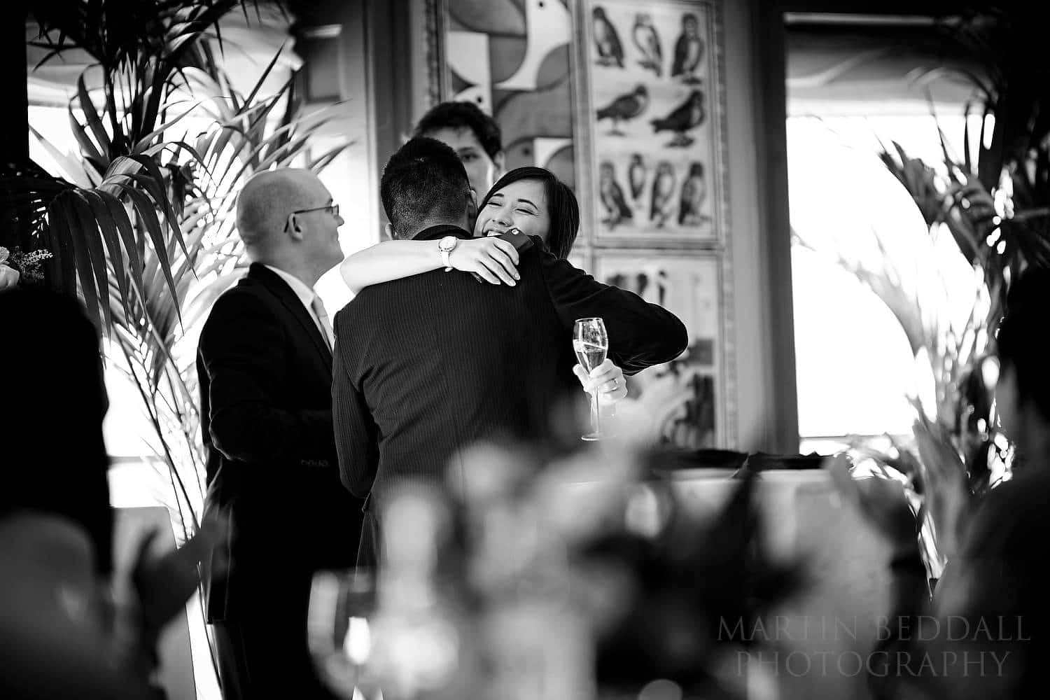 Bride hugs her brother after his speech