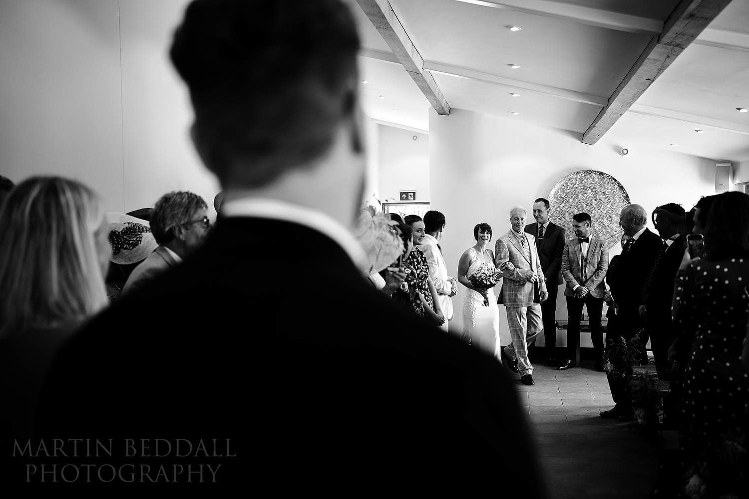 Bride escorted in by her father