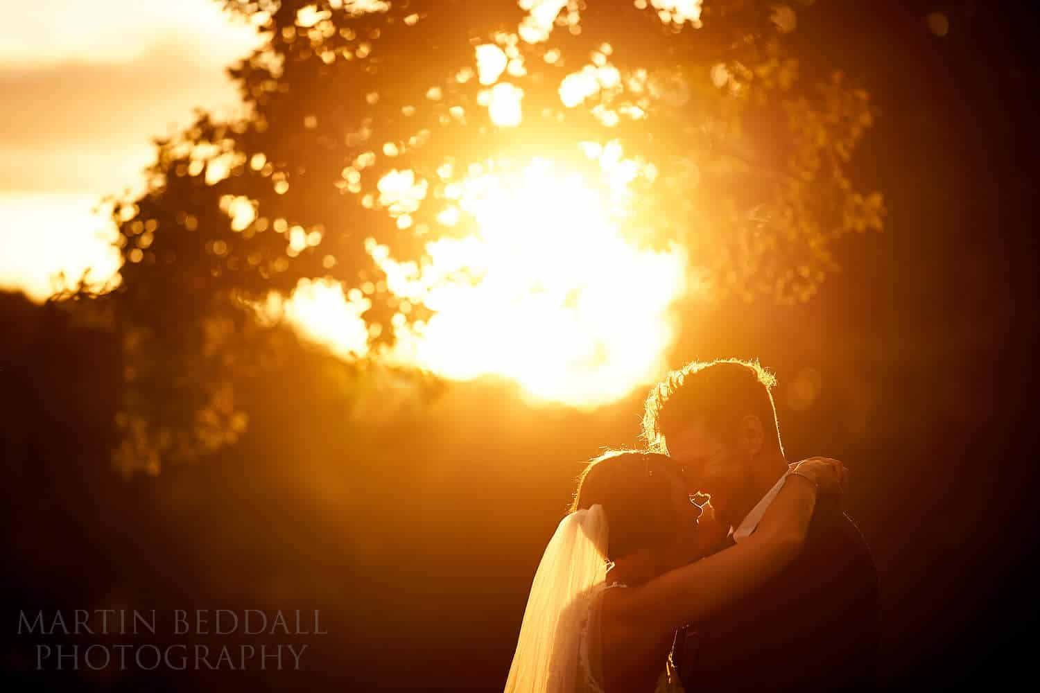 Sunset portrait of the bride and groom at Oak Barn wedding