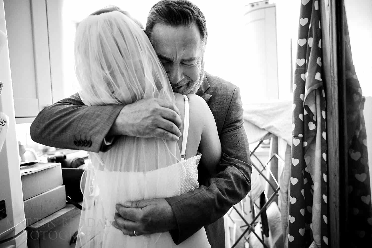 Hug for the bride from her emotional father
