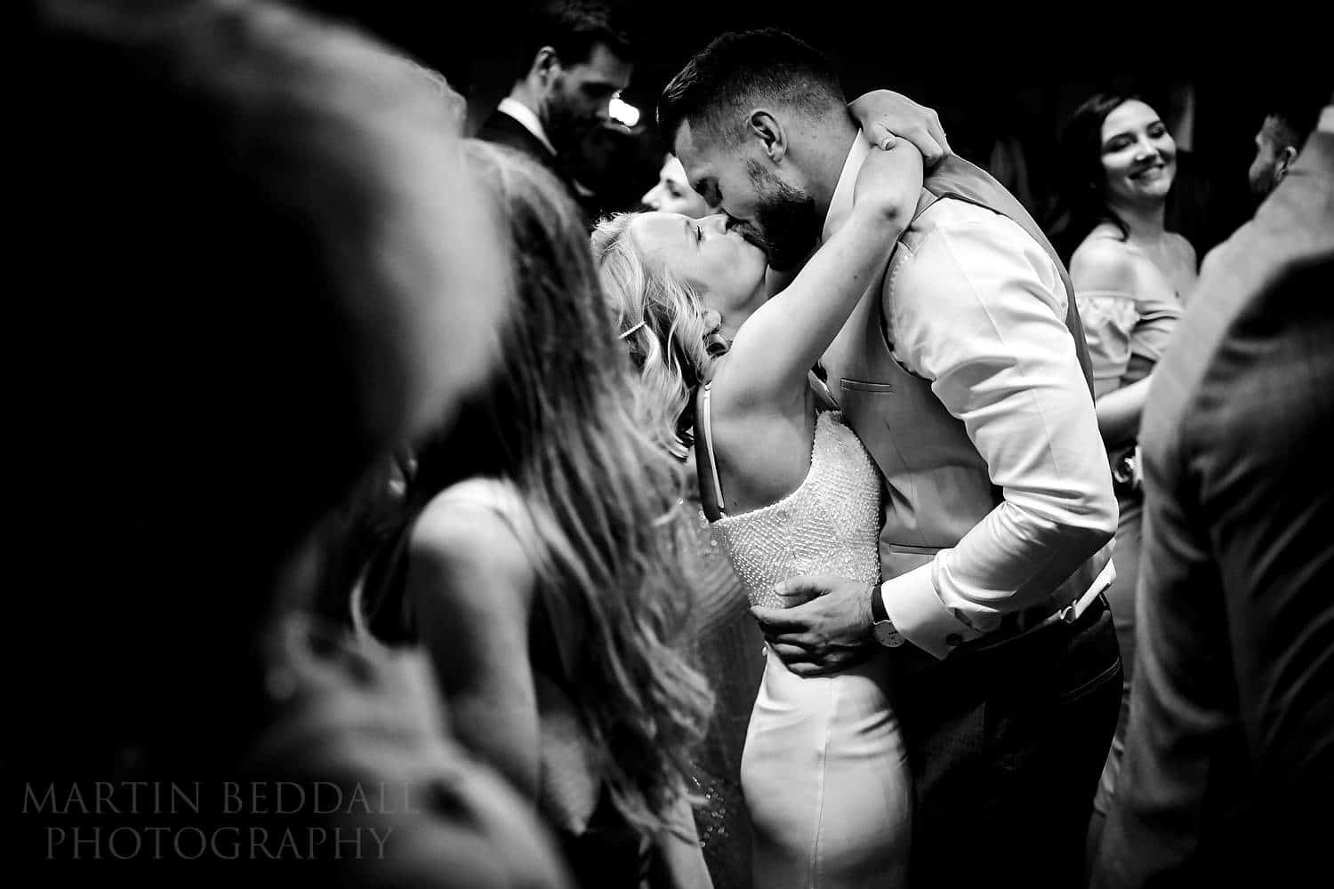 Bride and groom kiss on the dance floor at Boathouse 4