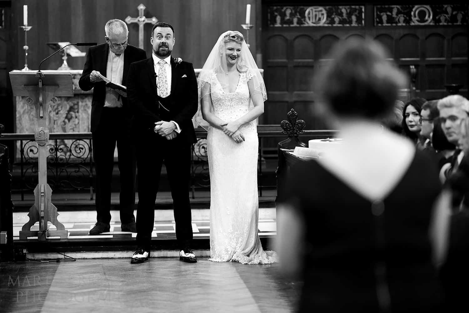 Groom reacts to his sister singing