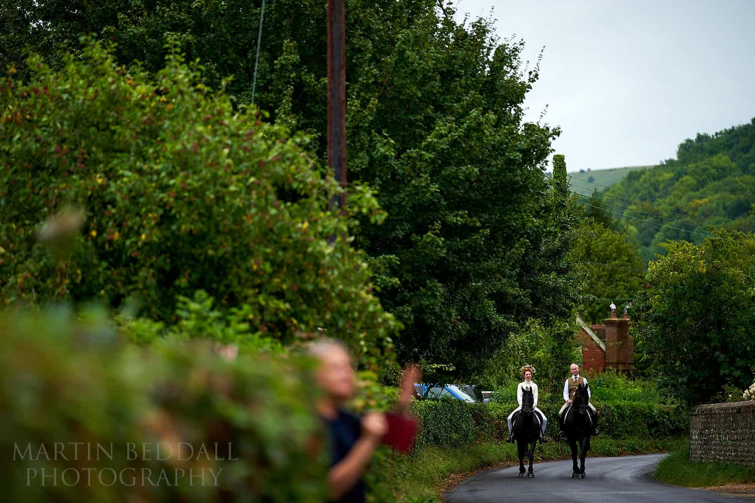 Bride and her father arrive at the church on horseback