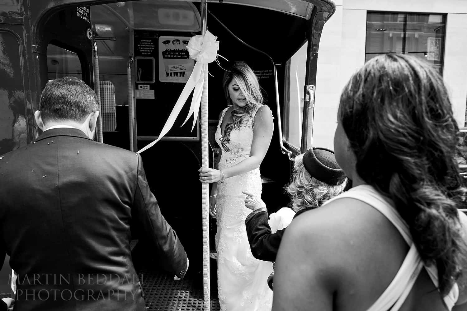 Bride gets onto the Routemaster bus