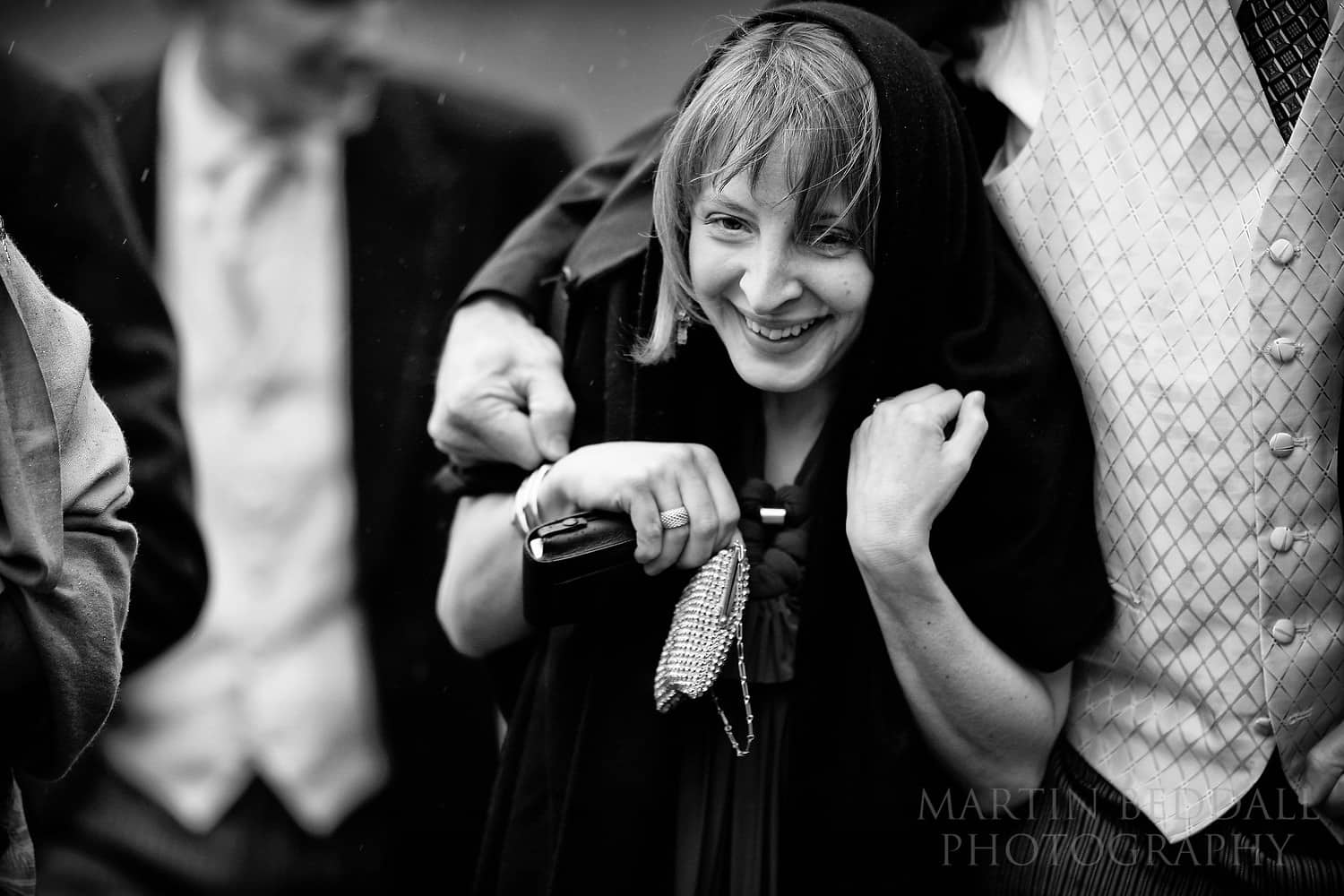 Wedding guest sheltering from the rain