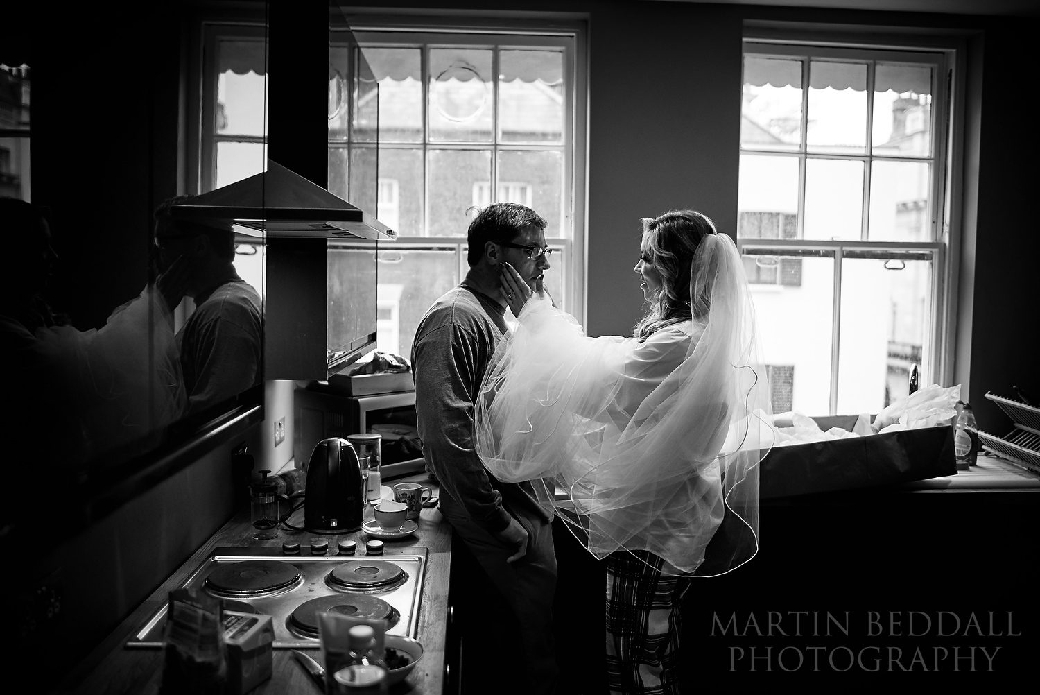 A reportage moment between a bride and her father