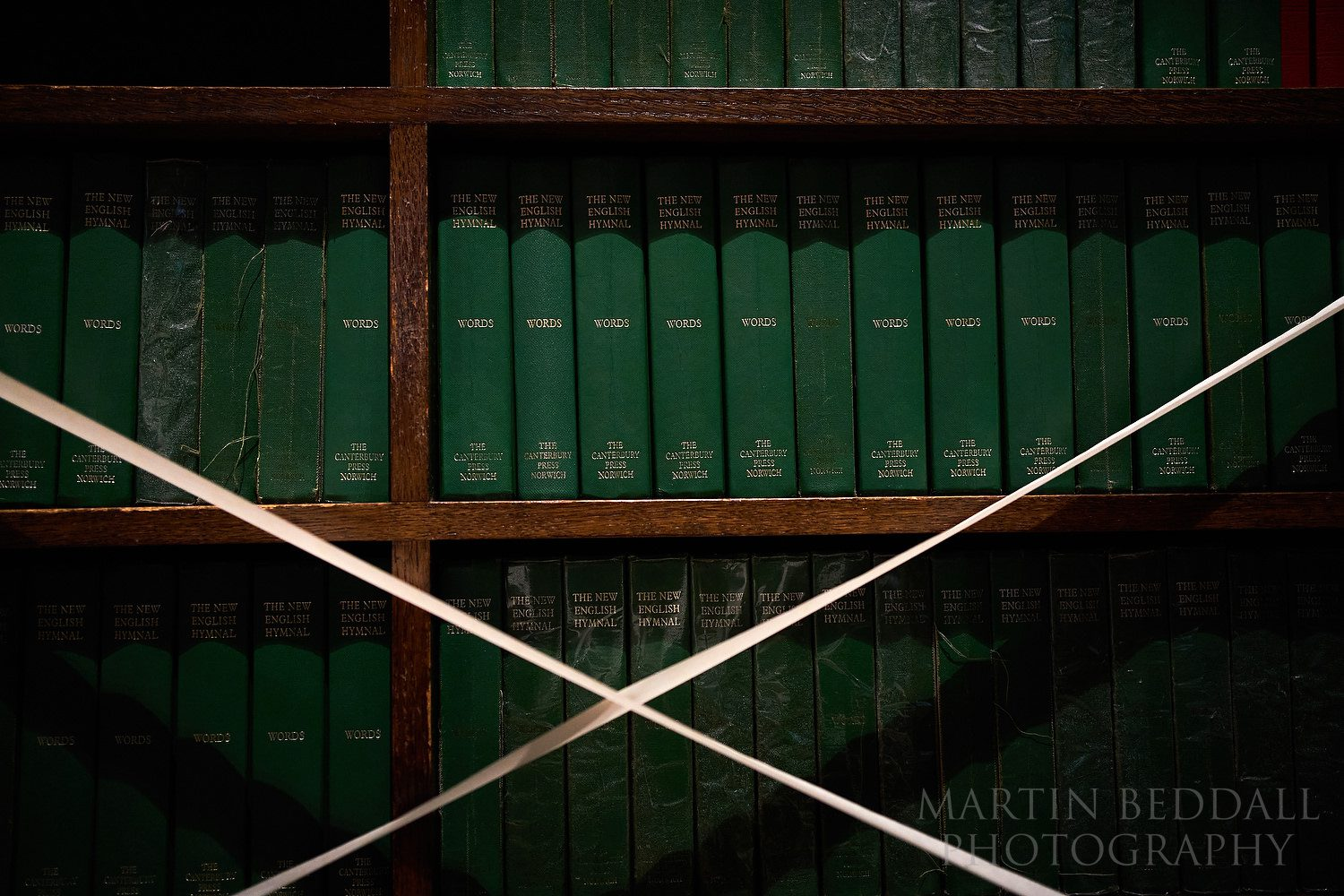 Hymn books taped off due to covid-19 restrictions at post-lockdown wedding