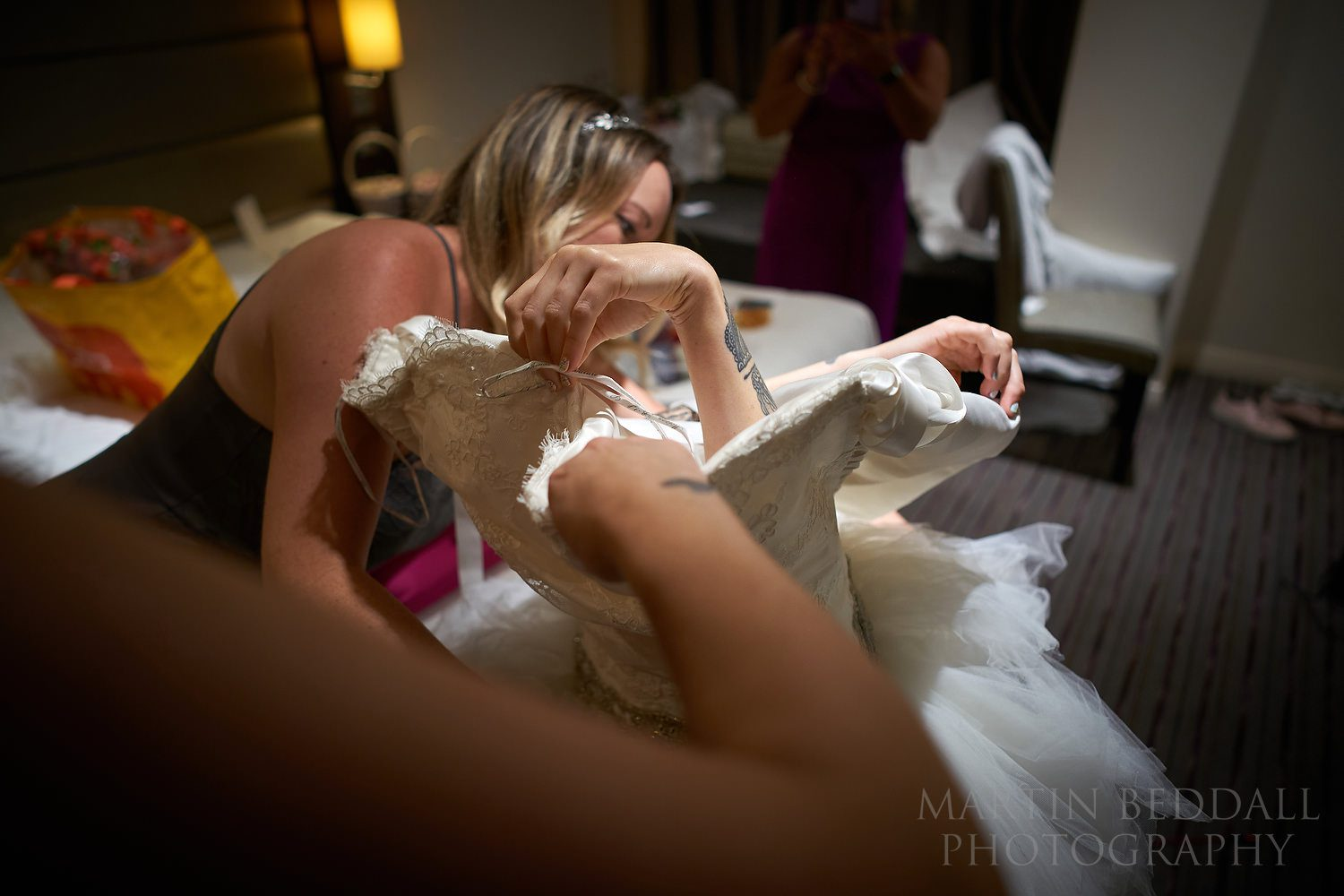 Bride emerges from the wedding dress