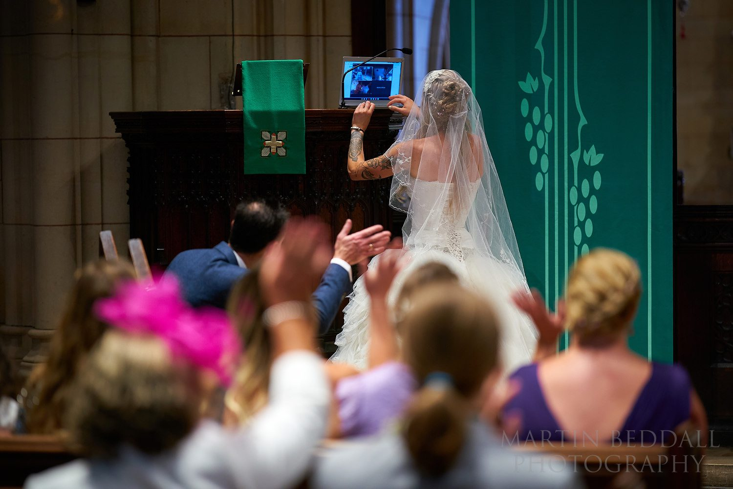Setting up the laptop for Zoom at a post-lockdown wedding