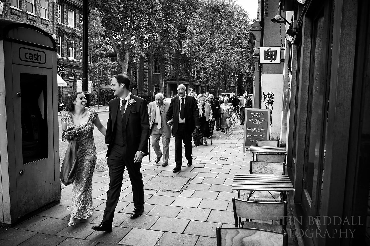 Bride and groom lead the way to the restaurant